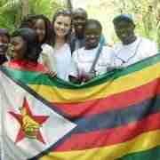 Young Zimbabweans hold up a Zimbabwean flag