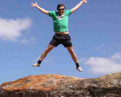 Man jumping on a Domboshawa boulder - a fantastic experience in Zimbabwe